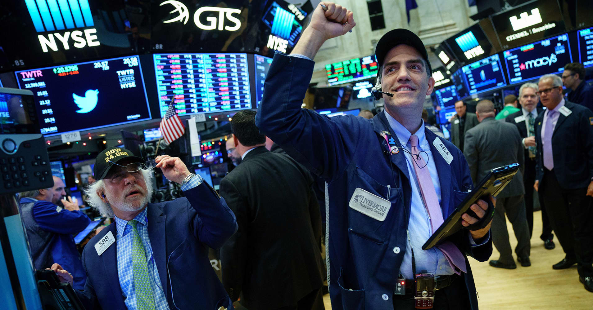 Traders work on the floor of the New York Stock Exchange (NYSE) at the closing bell, November 30, 2017 in New York City. On Thursday afternoon, the Dow closed at over 24,000 points for the first time in its history.