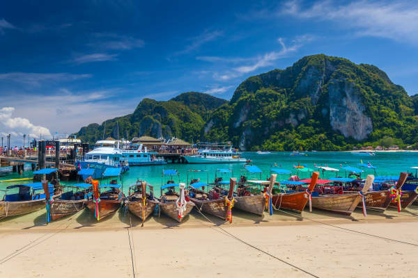 Row of longtail boats at Phi Phi island in Phuket, Thailand.