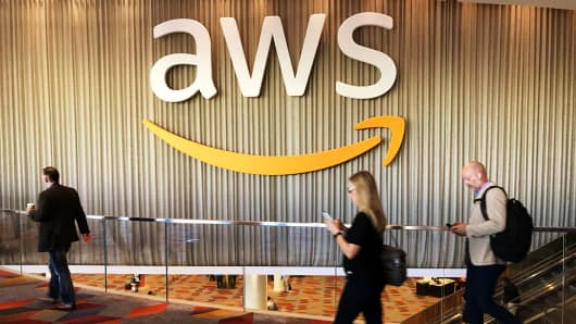 Attendees at Amazon.com annual cloud computing conference walk past the Amazon Web Services logo in Las Vegas, November 30, 2017.