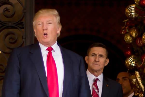 This December 21, 2016 file photo shows US President-elect Donald Trump (L) with with Trump National Security Adviser designate Lt. General Michael Flynn (R) at Mar-a-Lago in Palm Beach, Florida.