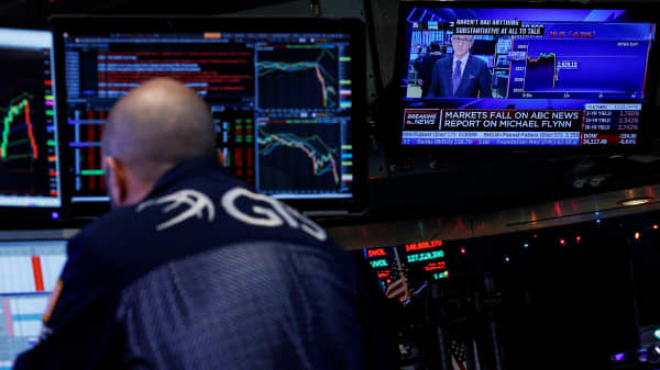 A specialist trader works at his post on the floor, as a television displays the news about former U.S. national security adviser Michael Flynn, at the New York Stock Exchange, (NYSE) in New York, U.S., December 1, 2017.
