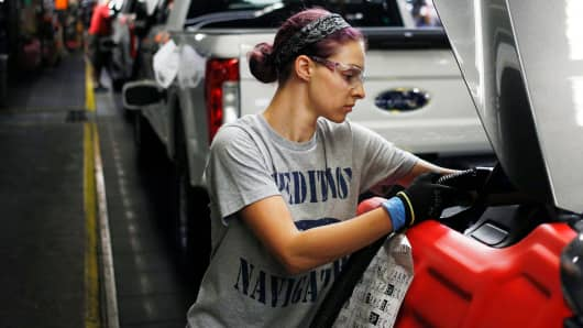 An employee works on a Ford Expedition sports utility vehicle on the assembly line at the Ford Kentucky Truck Plant in Louisville, Kentucky.