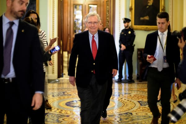 Senate Majority Leader Mitch McConnell (R-KY) leaves the Senate floor during debate over the Republican tax reform plan in Washington, U.S., December 1, 2017.