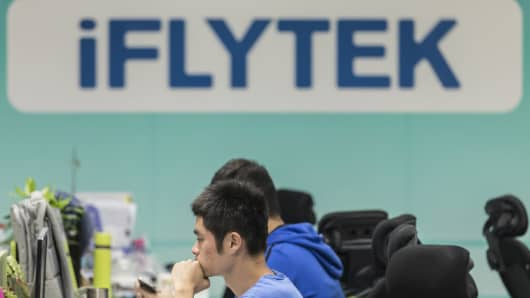 Employees work at their desks inside Iflytek's regional headquarters in Guangzhou, China, on Tuesday, Oct. 31, 2017.