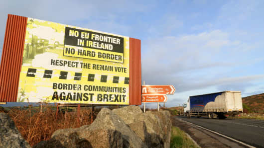 Traffic passes a Brexit Border poster on the Dublin road Co Armagh border, between Newry in Northern Ireland and Dundalk in the Irish Republic, on December 1, 2017, The European Union will not accept Britain's Brexit offer if Ireland is not satisfied with proposals for future border arrangements, EU President Donald Tusk said in Dublin on December 1, 2017.