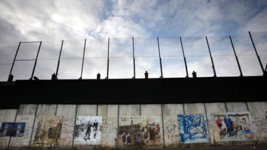 The 'Peace Line' fence is seen on February 9, 2005 that stretches between the Catholic and Protestant areas of West Belfast, Northern Ireland.