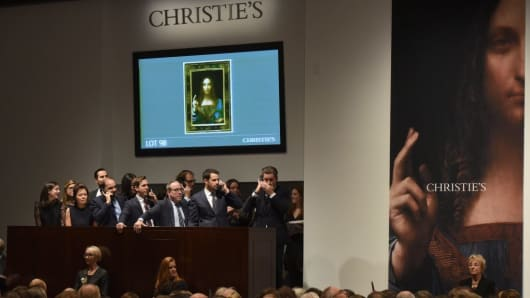 Christie's employees take bids for Leonardo da Vincis 'Salvator Mundi' at Christie's New York November 15, 2017.