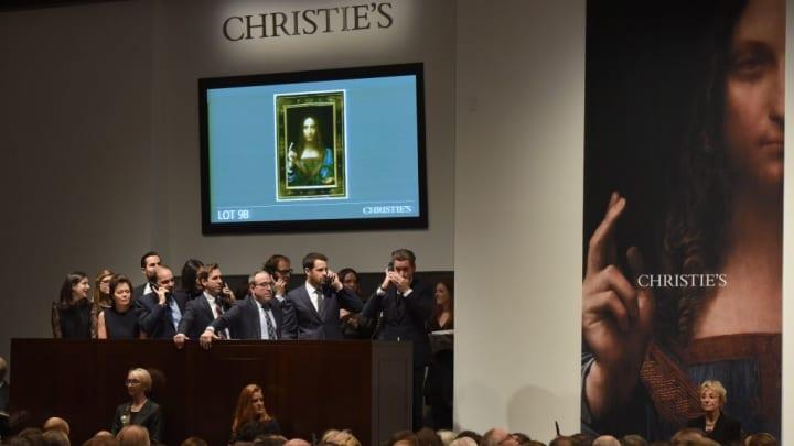 Christie's employees take bids for Leonardo da Vincis 'Salvator Mundi' at Christie's New York November 15, 2017.