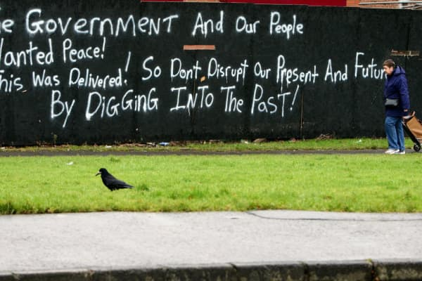 Fresh graffiti in a Loyalist area of Belfast as Northern Ireland's political parties faced increasing pressure to agree a deal to save the region's power-sharing government (2010).