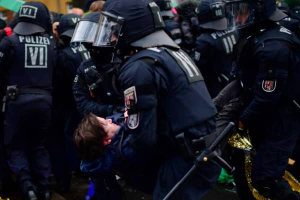 Left-wing protesters clash with police forces outside the Hannover Congress Centrum (HCC) prior to