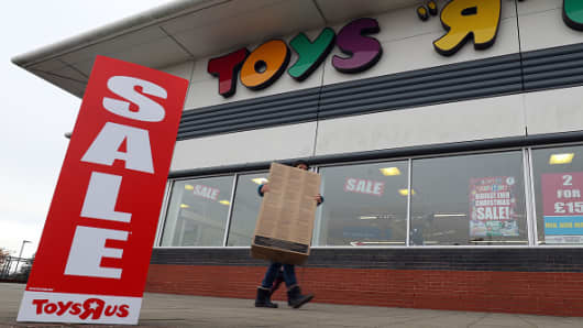 Sale signs outside a Toys R Us store in Basingstoke, Hampshire, as the company has put forward plans to close at least 26 U.K. stores, putting up to 800 jobs at risk.