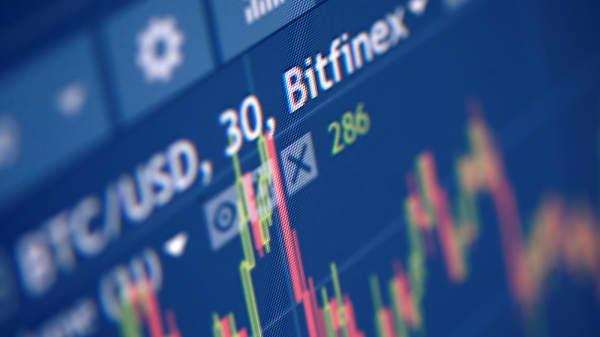 Photo illustration of Bitfinex cryptocurrency exchange website.