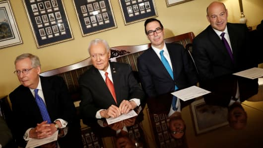 (L-R) Senate Majority Leader Mitch McConnell, Sen. Orrin Hatch, Treasury Secretary Steve Mnuchin and Director of the National Economic Council Gary Cohn introduce the Republican tax reform plan at the U.S. Capitol in Washington, U.S., November 9, 2017.