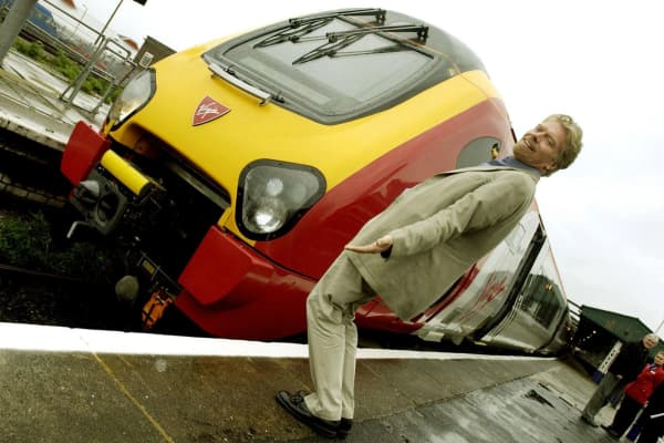 Sir Richard Branson during the launch of Virgin Trains 'tilting train' at Reading Station. The first tilting train to carry fare-paying passengers is being operated by Sir Richard Branson's Virgin Trains company. Sir Richard joined customers o