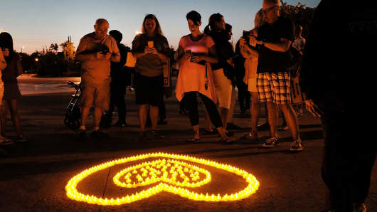 People attend a candlelight vigil for victims of drug addiction on August 24, 2017 in Staten Island, New York. Dozens of Staten Island residents attended the evening vigil which celebrated the lives and gave remembrance to those that have died from drug addiction. According to the Department of Health, at least 107 people died from opioid overdoses in the borough last year, the highest number on record and a 35 percent increase from 2015.