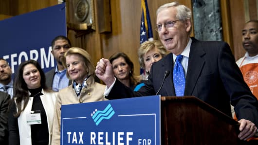 Senate Majority Leader Mitch McConnell, a Republican from Kentucky, right, speaks during a news conference on tax reform in Washington, D.C., U.S., on Thursday, Nov. 30, 2017.