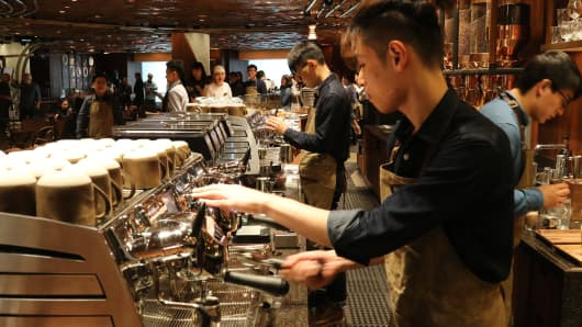 Baristas working at the new Starbucks Reserve Roastery in Shanghai, China.