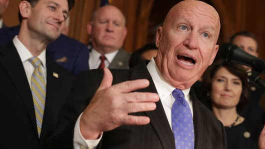House Ways and Means Committee Chairman Kevin Brady (R-TX) (R) speaks during a news conference with Speaker of the House Paul Ryan (R-WI) and fellow House Republicans following the passage of the Tax Cuts and Jobs Act in the Rayburn Room at the U.S. Capitol November 16, 2017 in Washington, DC.