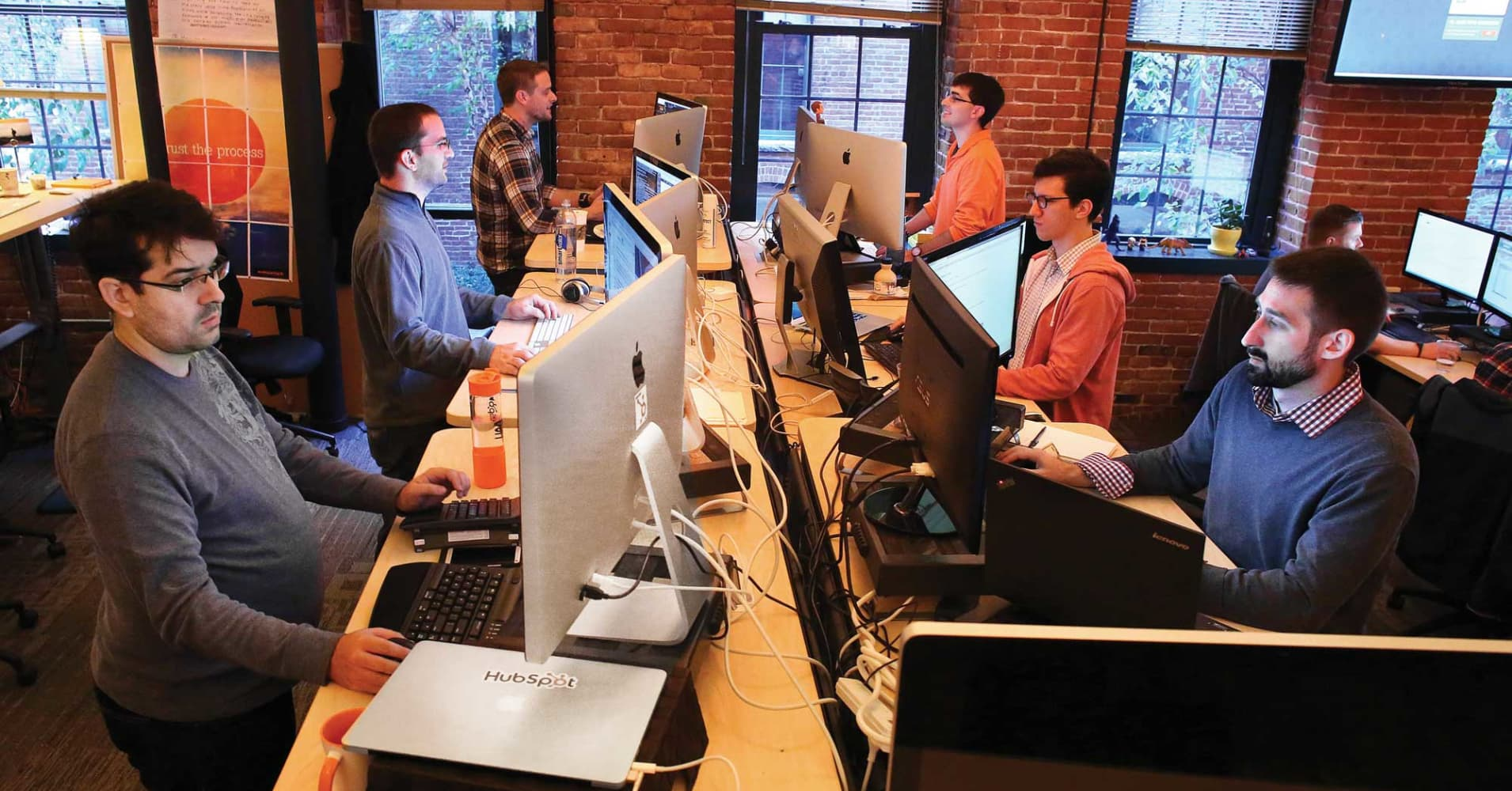 HubSpot employees work at their standing desks in Cambridge, Mass.