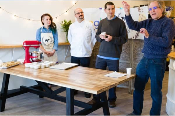 Google employees at the Gluten Free Goat Bakery & Cafe testing their AI-generated recipes.