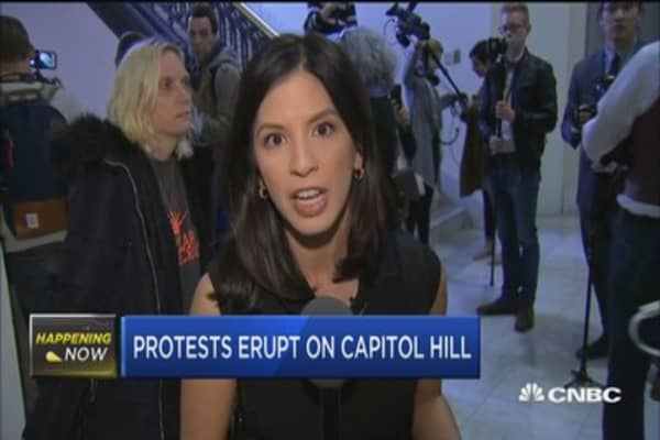 Protests erupt on Capitol Hill over tax bill
