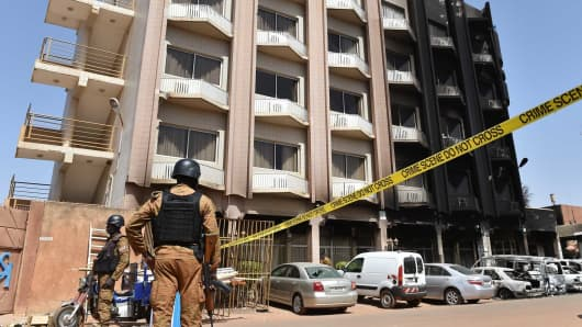 Burkina Faso troops stand guard outside Splendid Hotel in Ouagadougou on January 18, 2016 following a jihadist attack by Al-Qaeda-linked gunmen late on January 15. Security forces are hunting for any possible surviving gunmen from the attack claimed by Al-Qaeda in the Islamic Maghreb (AQIM) that left at least 30 people dead and showed the expanding reach of regional jihadists in west Africa.