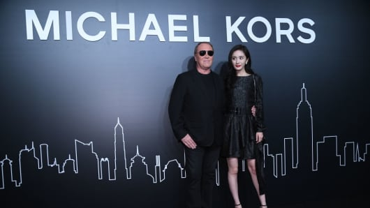 Actress Yang Mi poses with designer Michael Kors at an event in Shanghai, China, on Nov. 15, 2017.