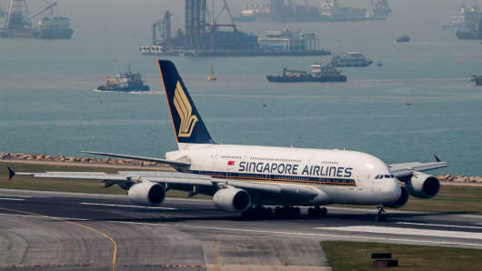 A Singapore Airlines passenger plane takes a taxi on the runway of the Hong Kong International Airport on October 23, 2017.