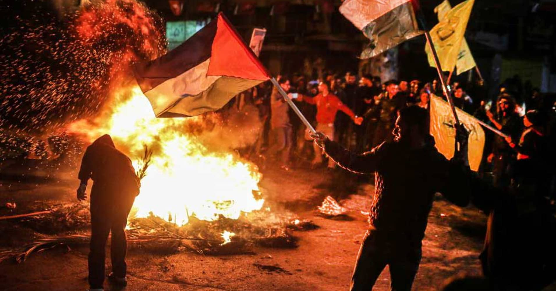 Demonstrators burn tires, shout slogans and hold Palestinian flags during a protest against US President Donald Trump's recognition of Jerusalem as Israel's capital, in Gaza City, Gaza on December 07, 2017.