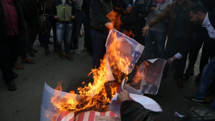 "Palestinian protesters burn the US and Israeli flags in Gaza City on December 7, 2017. Haniya called for a new Palestinian intifada, or uprising. This Zionist policy supported by the US cannot be confronted unless we ignite a new intifada,"" the head of the armed Palestinian Islamist movement that runs the Gaza Strip said in a speech."