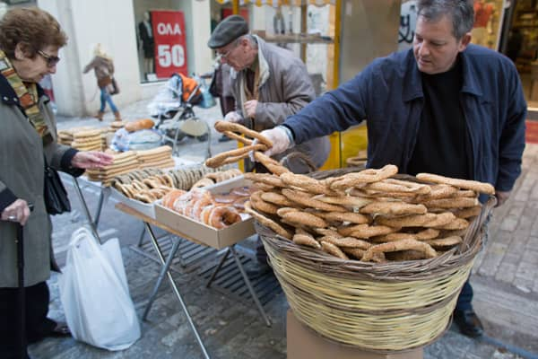 Street vendors sell bread from a stall in the main shopping area following the electoral success by Syriza in the Greek general election on January 26, 2015 in Athens, Greece.