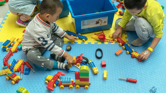 Children playing with Lego sets in Tianjin, China.