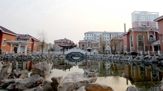 A group of villas built on re-zoned farmland by Yucheng power grid company in Yucheng, a county in north China's Henan province.