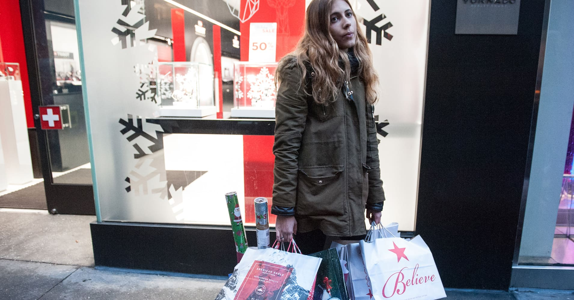 A shopper holds a number of gift bags along Fifth Ave. on December 24, 2016 in New York City.