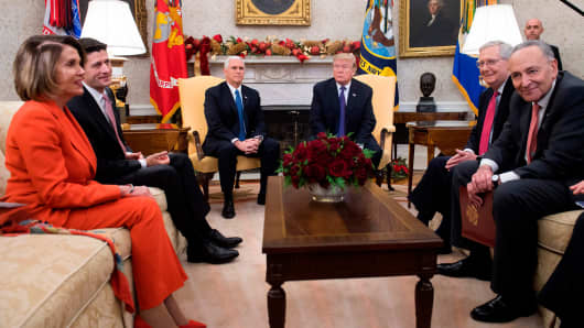 President Donald Trump, alongside Vice President Mike Pence (3rd L), meets with Congressional leadership including Senate Majority Leader Mitch McConnell (2nd R), Republican of Kentucky, Senate Minority Leader Chuck Schumer (R), Democrat of New York, Speaker of the House Paul Ryan (2nd L), Republican of Wisconsin, and House Democratic Leader Nancy Pelosi (L), Democrat of California, in the Oval Office at the White House in Washington, DC, December 7, 2017.