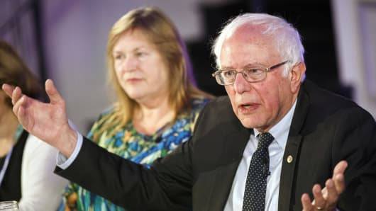 Senator Bernie Sanders, an independent from Vermont, speaks as his wife Jane Sanders looks on.