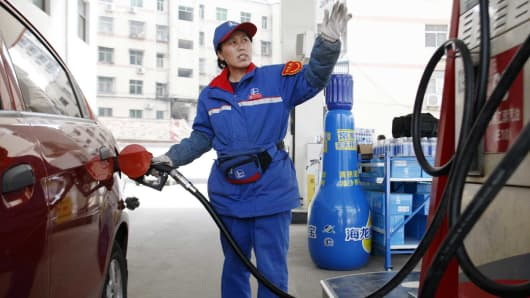 A female staff works at a gas station in Huaibei, Anhui province, China.