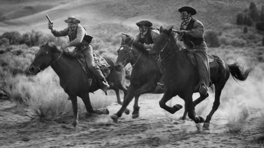 Dawson's henchmen attempt to rob a stagecoach during a scene from the film 'Trail Of The Vigilantes', directed by Allan Dwan.