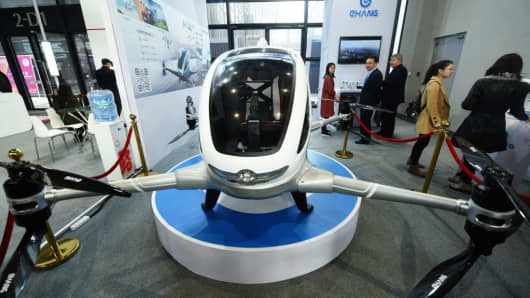 An unmanned passenger-carrying EHang 184 drone is on display.