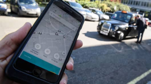 A phone displays the Uber ride-hailing app on September 22, 2017 in London, England. Uber is appealing Transport for London's decision not to renew its operating license.