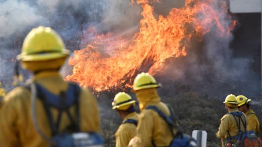 Fire fighters attack the Thomas Fire's north flank with backfires as they continue to fight a massive wildfire north of Los Angeles, near Ojai, California, December 9, 2017.