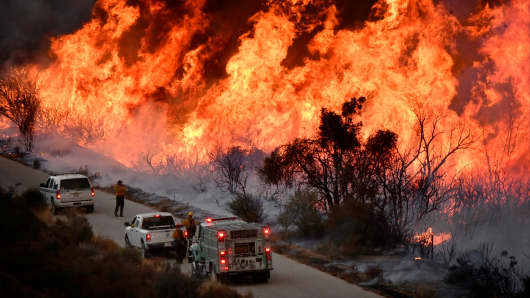 Fire fighters attack the Thomas Fire's north flank with backfires as they continue to fight a massive wildfire north of Los Angeles, near Ojai , California, U.S., December 9, 2017.