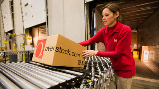 A United Parcel Service Inc. (UPS) worker loads orders onto a truck in the shipping area at the Overstock.com Inc. distribution center in Salt Lake City, Utah.