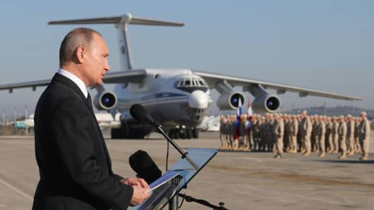 Russia's President Vladimir Putin addresses Russian forces at the Russian Khmeimim air base.