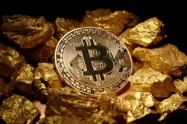Bitcoin on a mound of gold.