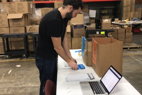 Alex Morgia, 31, packs rolls of his Donald Trump dog poop bags at his warehouse in upstate New York.