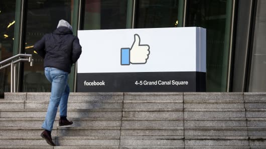 A visitor enters the Facebook European headquarters in Dublin, Ireland.