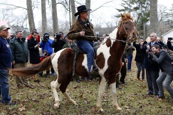 Republican candidate for U.S. Senate Judge Roy Moore rides his horse after voting in Gallant, Alabama, U.S., December 12, 2017.