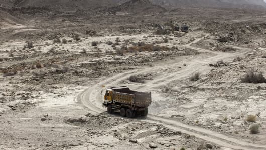A truck arrives at a site where workers gather materials for the construction of the M8 motorway on the outskirts of Gwadar, Balochistan, Pakistan, on Wednesday, Aug. 3, 2016. Gwadar is the cornerstone of Chinese President Xi Jinping's Belt and Road project to rebuild the ancient Silk Road