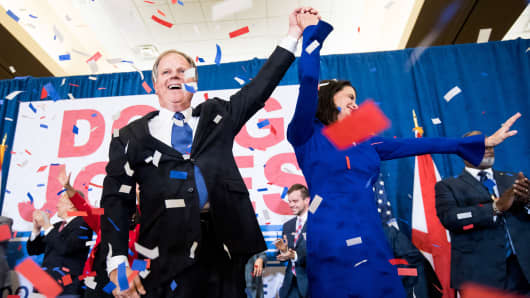 Alabama Democrat Doug Jones celebrates his apparent victory over Judge Roy Moore in a special Senate election on Tuesday, Dec. 12, 2017.
